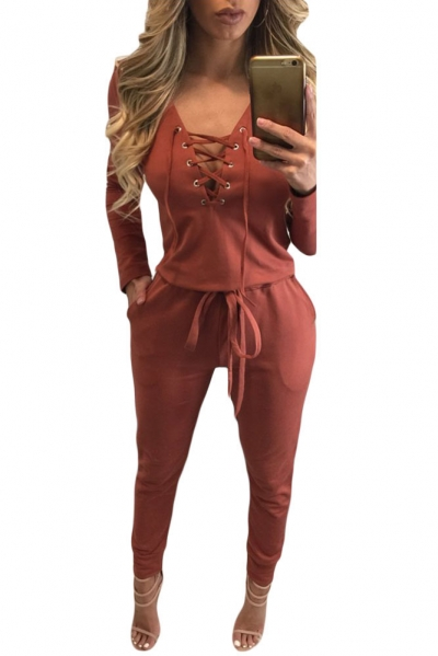 Orange Grommet Lace Up Long Sleeve Jumpsuit